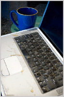 Laptop with spilled coffee
